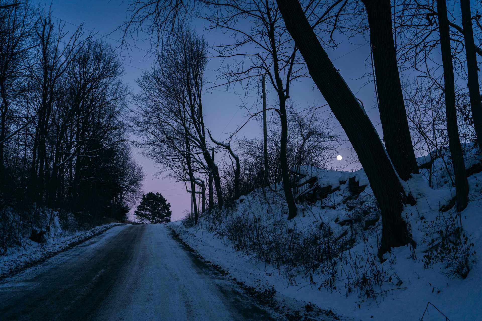 Snowy, rural road at Blue hour near ‎⁨Magnolia⁩, ⁨Illinois
